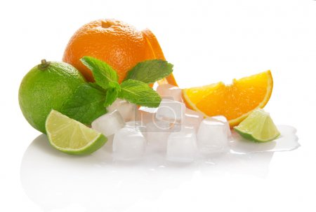 Photo for Oranges, limes, mint, cubes of ice and slices citrus, isolated on white - Royalty Free Image