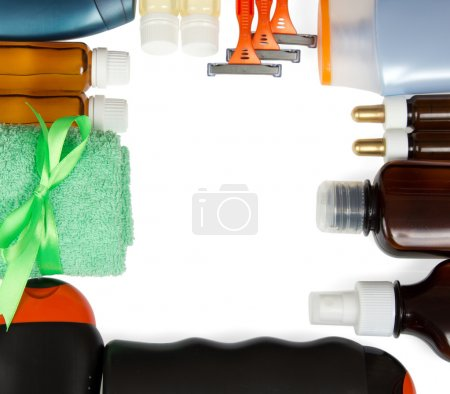 Set of man's cosmetics and the terry towel isolated on white