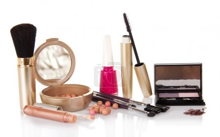 Lip gloss, mascara, eye shadow, the blush and the nail varnish, isolated on white
