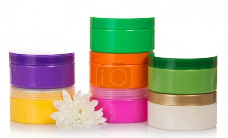 Collection of various beauty hygiene containers and chrysanthemum, isolated on white