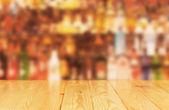 Light wood worktop in front of bar