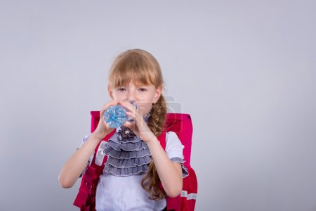 Girl drinking water from a plastic bottle