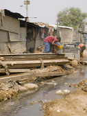 Poor man in the slums in India