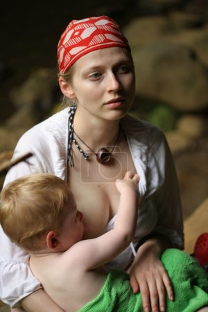 Mother breastfeeding child