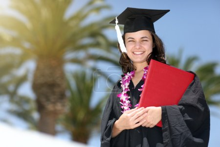 Photo for Happy graduate with diploma. Closeup, shallow DOF. - Royalty Free Image