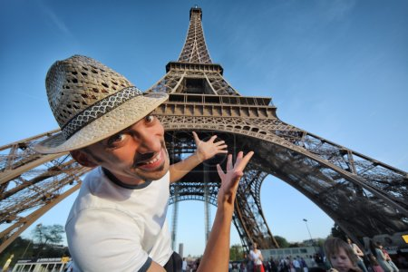 Tourist pointing to Eiffel Tower in Paris