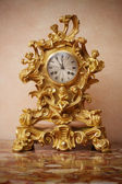Vintage golden clock.