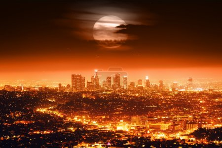 Photo for Dramatic full moon over Los Angeles skyline at night. - Royalty Free Image