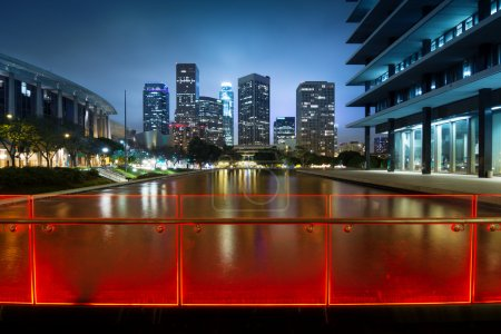 Photo for Downtown Los Angeles skyline reflects in water at night. - Royalty Free Image