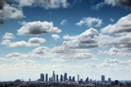Photo for Downtown Los Angeles skyline under blue sky with scenic fluffy clouds. - Royalty Free Image