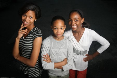 Three teenage sisters
