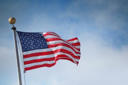 Photo for Flag of the United States of America over blue sky background - Royalty Free Image