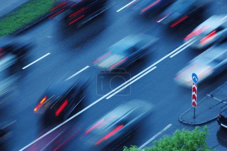 Photo for Cars moving over wet road background. Blurred motion. - Royalty Free Image