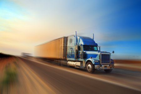 Photo for American truck speeding on freeway at sunset, motion blurred. - Royalty Free Image