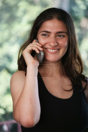 Beautiful girl talikng on cell phone