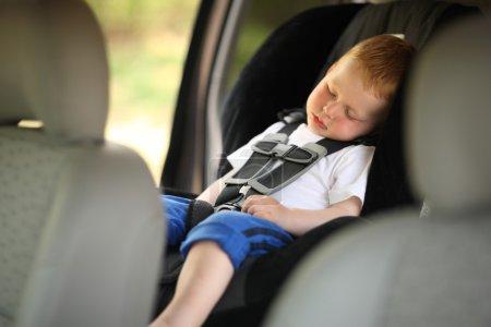 Boy sleeping in child car seat