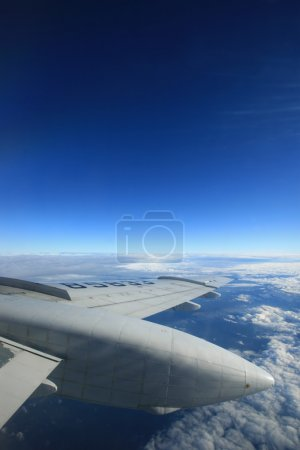 Airplane wing and blue sky.