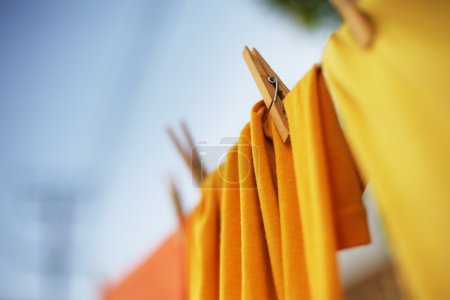 Colorful clothes drying on clothesline