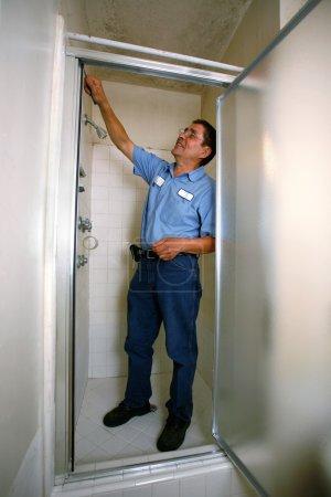 contractor fixing shower