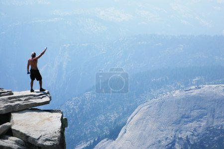 Man standing on top of a cliff