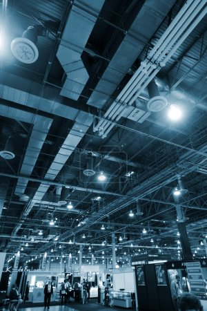 Photo for Huge industrial space hosting a trade show. - Royalty Free Image