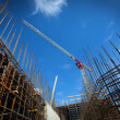 Construction site with cranes on sky background...