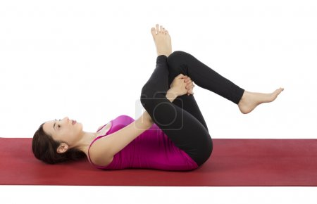 Photo for Woman is in eye of the needle pose in yoga. - Royalty Free Image