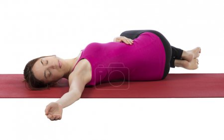 Young woman stretching her back during yoga