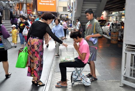 Bangkok, Thailand: Blind People Begging on Silom Road