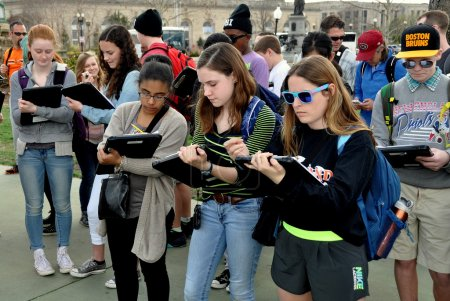 Photo for Washington, DC:   A group of students on a field trip taking notes while standing in the plaza of the Grant Memorial near the National Mall - Royalty Free Image