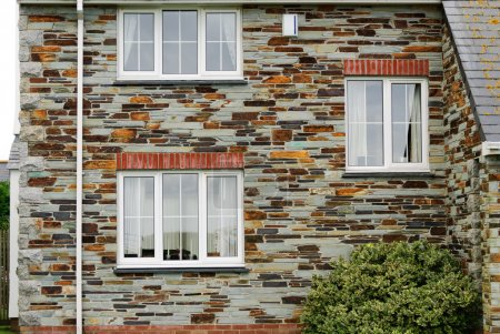 Detail of stone wall house in Tintagel in Cornwall...