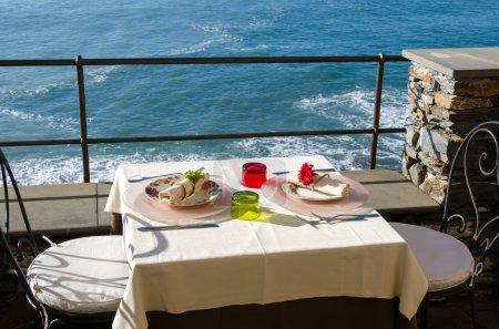 Table set on the sea