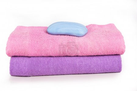 Photo for Two towels with a soap on it - Royalty Free Image