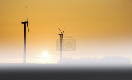 Windmill in fog and sunset...