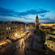 Krakow Market Square at sunset with night lights...