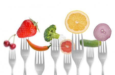 Photo for Vegetables and fruits on the collection of forks, diet concept - Royalty Free Image