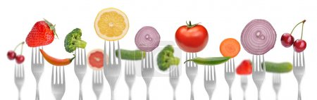 Photo for Diet concept .vegetables and fruits on the collection of forks - Royalty Free Image