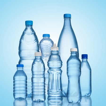 Photo for Many water bottles on blue background - Royalty Free Image