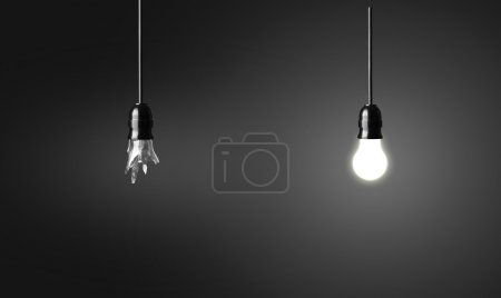 Photo for One broken and one glowing bulb. Idea concept on black background - Royalty Free Image