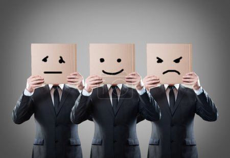 Photo for Businessman with mask of different emotions - Royalty Free Image