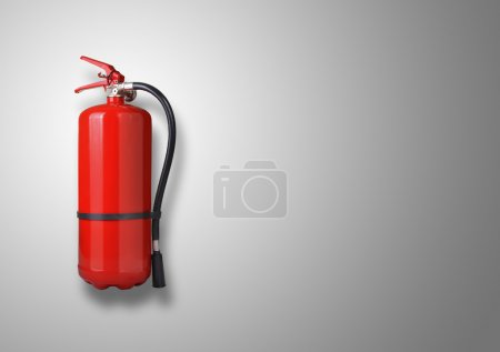 Fire extinguisher on gray background...
