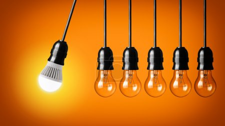 Photo for Perpetual motion with LED bulb and simple light bulbs - Royalty Free Image