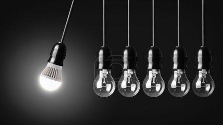 Photo pour Mouvement perpétuel avec ampoule LED et ampoules simples - image libre de droit