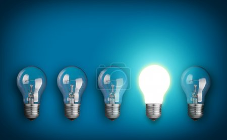 Photo for Idea concept with row of light bulbs and glowing bulb - Royalty Free Image