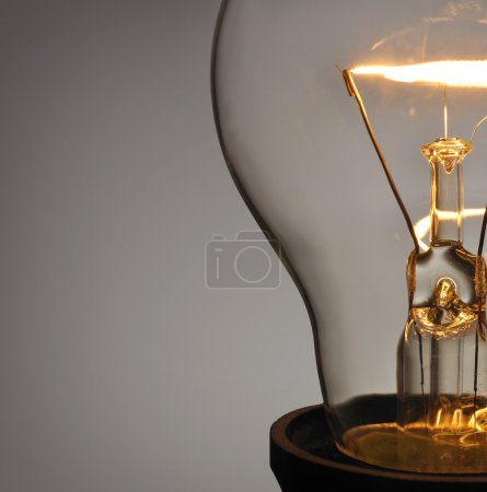 Photo for Close up glowing light bulb - Royalty Free Image
