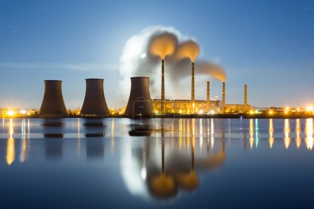 Photo for Moonrise over the thermal power plant. Donetsk, Ukraine - Royalty Free Image