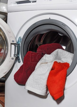 open washing machine with towels