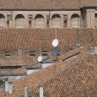 Italian roof Mantua with tile and satellite dish a...