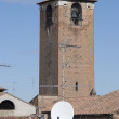Panorama with historical roof and satellite dish a...