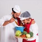 Постер, плакат: Italian Culinary Couple is Tasting Vegetable Soup